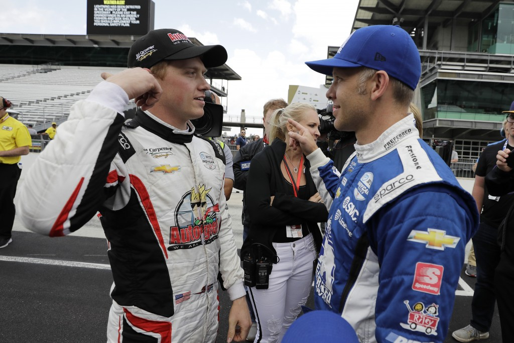 Spencer Pigot, left, talks with Ed Carpenter after qualifications for the Indianapolis 500 IndyCar auto race at Indianapolis Motor Speedway, Sunday, M