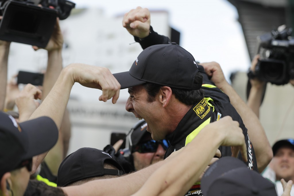 Simon Pagenaud, of France, celebrates with his crew after winning the pole for the Indianapolis 500 IndyCar auto race at Indianapolis Motor Speedway, ...