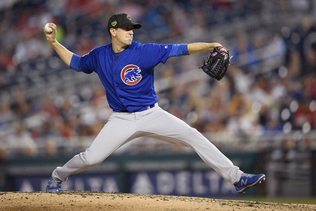Chicago Cubs starting pitcher Kyle Hendricks delivers during the fourth inning of a baseball game against the Washington Nationals, Sunday, May 19, 20