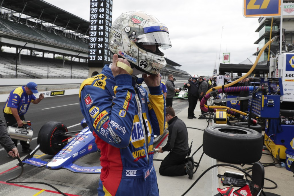 Alexander Rossi prepares to drive before the start of practice for the Indianapolis 500 IndyCar auto race at Indianapolis Motor Speedway, Monday, May ...