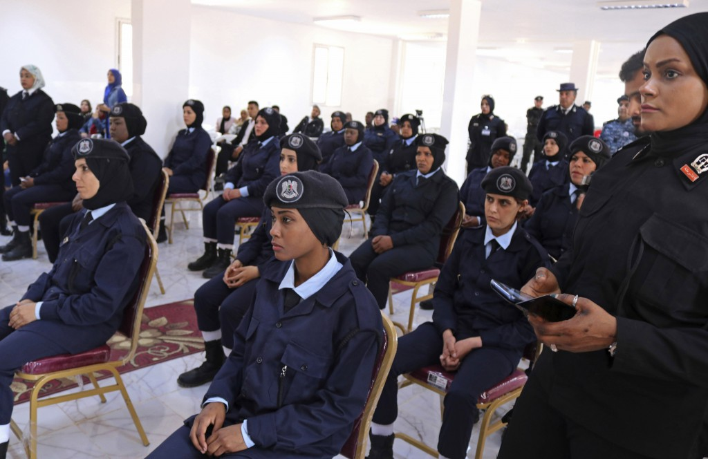 In this May 2, 2019 photo, policewomen cadets attend their graduation ceremony in Benghazi, Libya. After years of assassinations, bombings and militia
