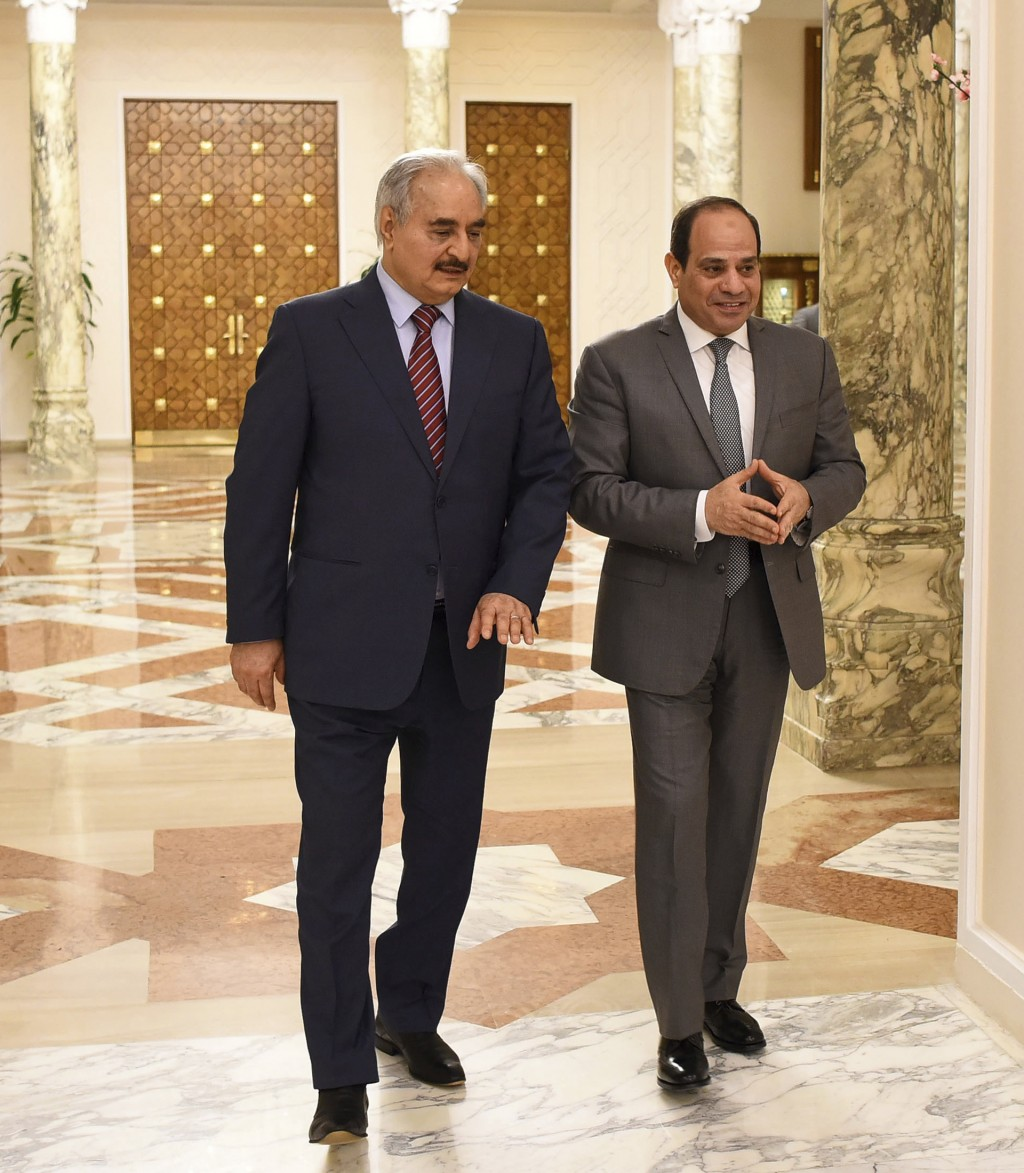 FILE - In this May 9, 2019 file photo, provided by Egypt's presidency media office, Egyptian President Abdel-Fattah el-Sissi, right, walks with Field