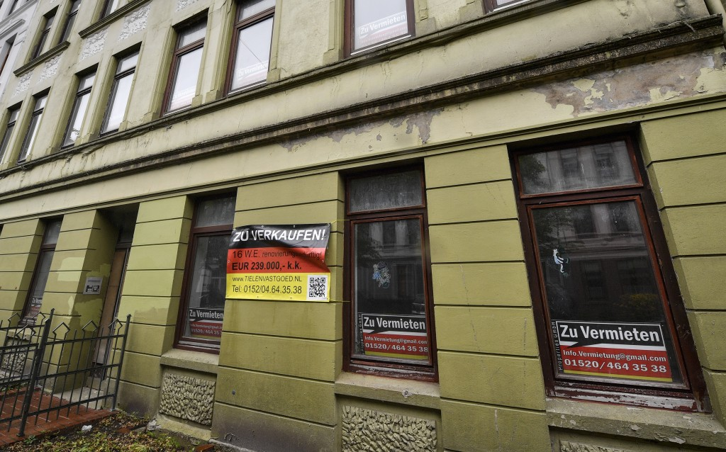 In this Thursday, May 16, 2019 photo an empty run-down apartment house is cheap for sale or rent in Bremerhaven, Germany. The city became a battlegrou