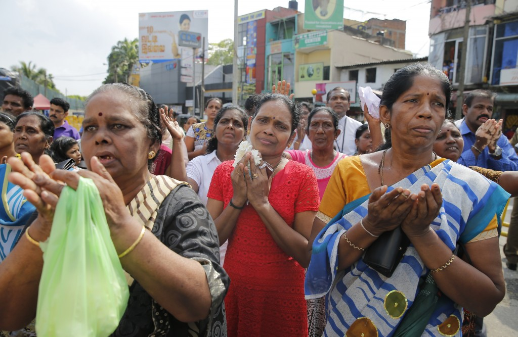 Sri Lankan Roman Catholic devotees pray out Side the St. Anthony's church, one of the sites of Easter Sunday attacks in Colombo, Sri Lanka, Tuesday, M...