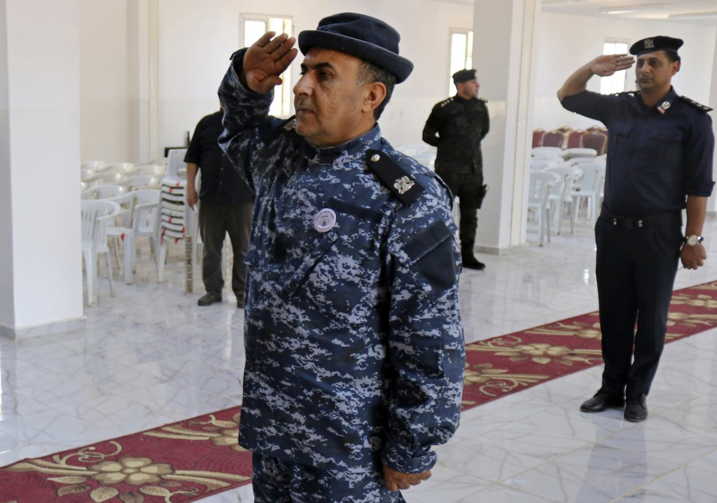 In this Thursday, May 2, 2019 photo, police attend their graduation ceremony in Benghazi, Libya. After years of assassinations, bombings and militia f