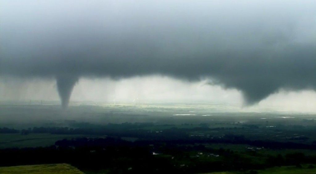 This image made from video provided by KWTV-KOTV shows two funnel clouds formed in Crescent, Okla., Monday, May 20, 2019. An intense storm system that