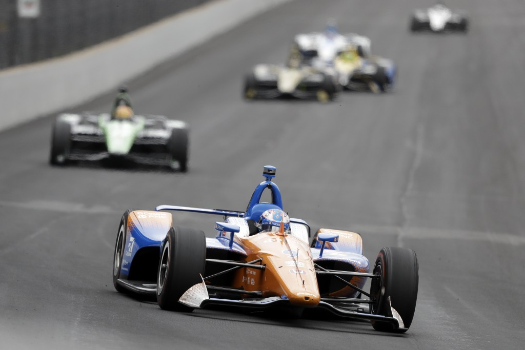 Scott Dixon, of New Zealand, drives into turn one during practice for the Indianapolis 500 IndyCar auto race at Indianapolis Motor Speedway, Monday, M...