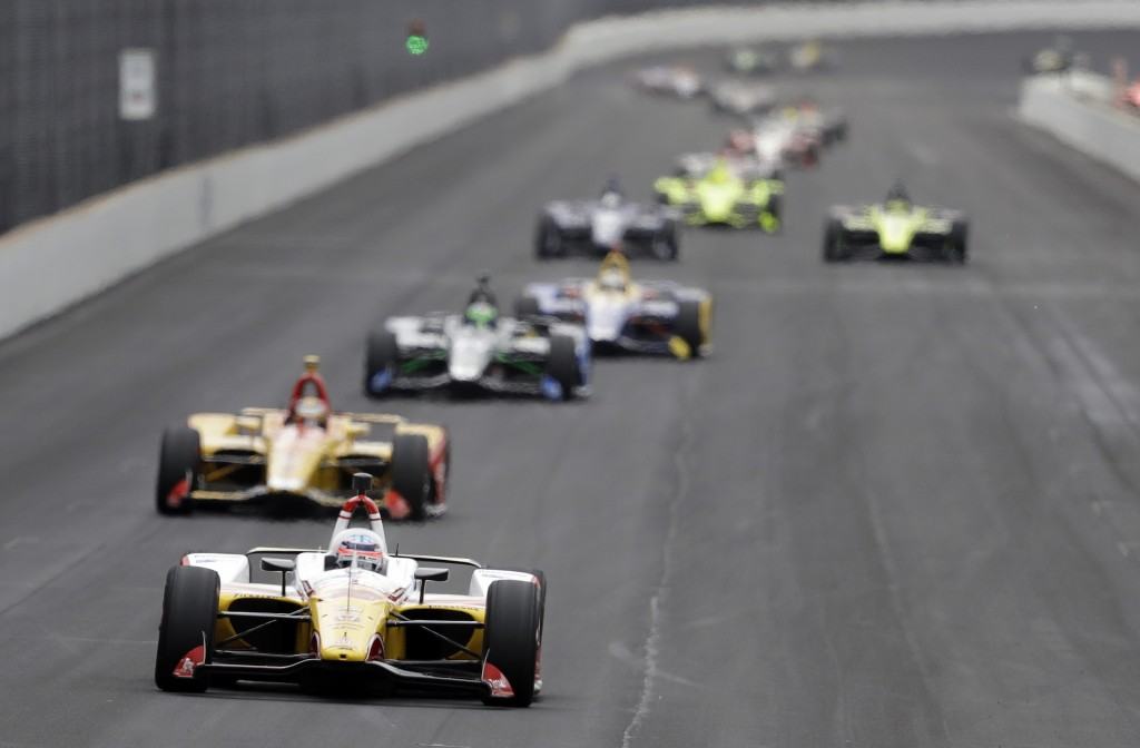 Takuma Sato, of Japan, leads a group of cars into turn one during practice for the Indianapolis 500 IndyCar auto race at Indianapolis Motor Speedway, ...