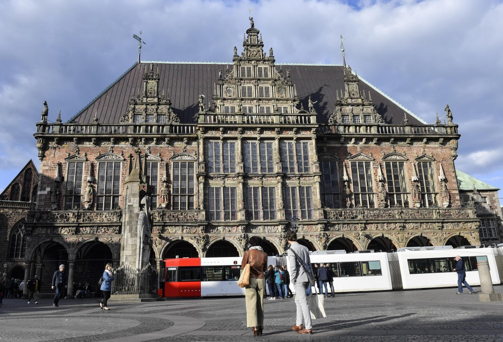 In this Tuesday, May 14, 2019 photo, the historic town hall shines in the evening sun in Bremen, Germany. The city became a battleground for EU's frag