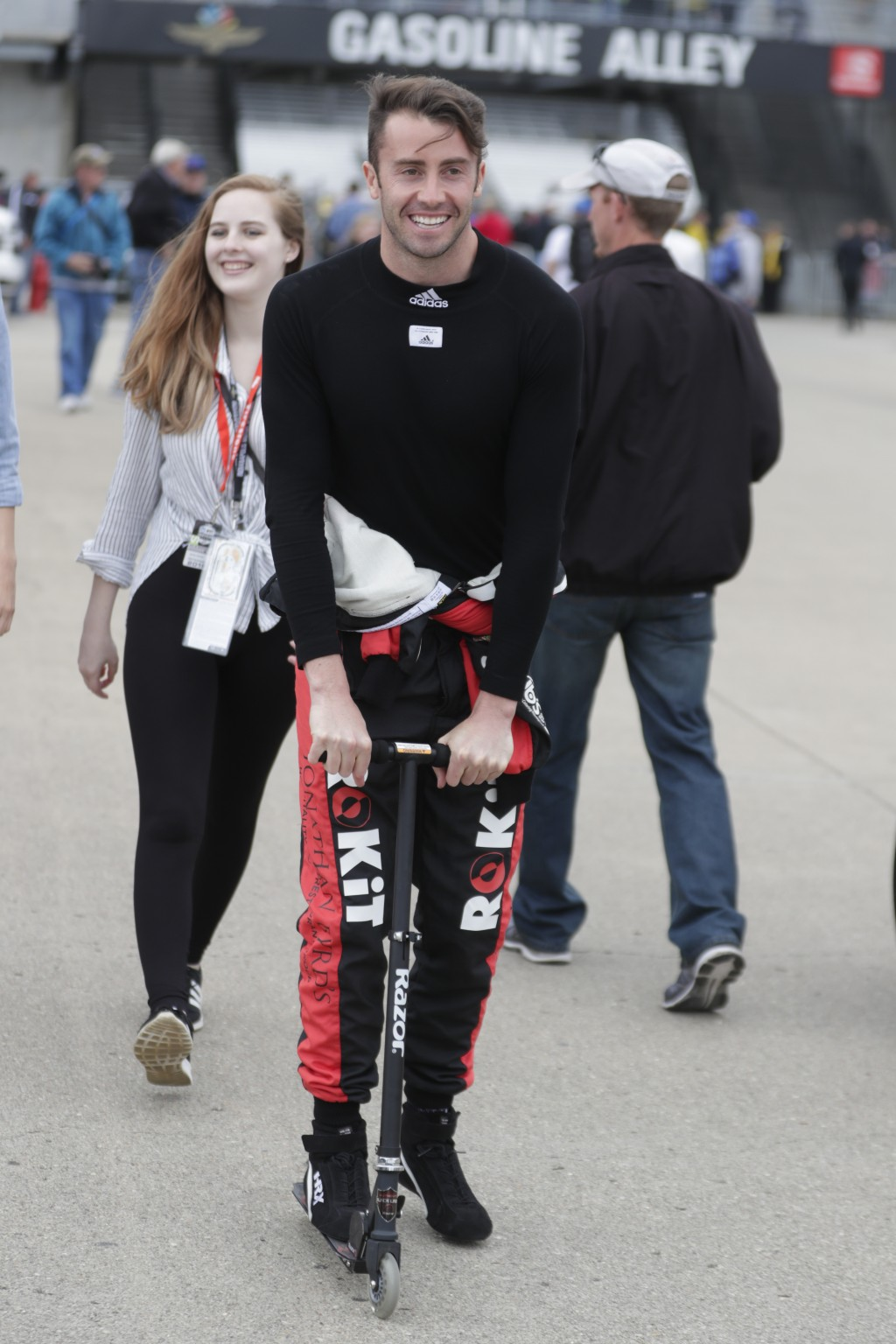 James Davison, of Australia, rides a scooter through the garage area practice for the Indianapolis 500 IndyCar auto race at Indianapolis Motor Speedwa...