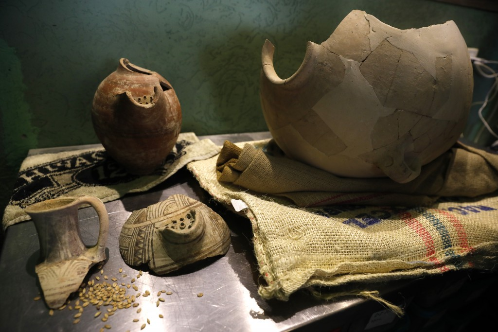Ancient jars are on display during a press conference in Jerusalem, Wednesday, May 22, 2019. Israeli researchers celebrated Wednesday a long-brewing p