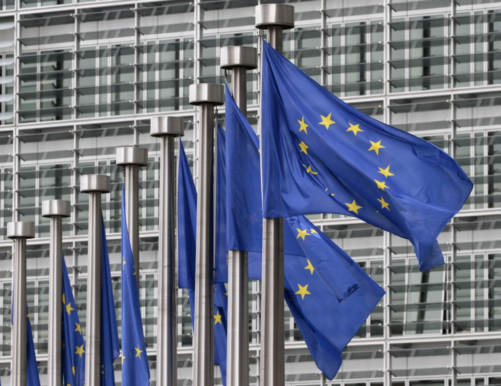 FILE - In this May 9, 2011 file photo, EU flags fly outside the European Commission headquarters in Brussels. Disinformation has evolved beyond the pl...