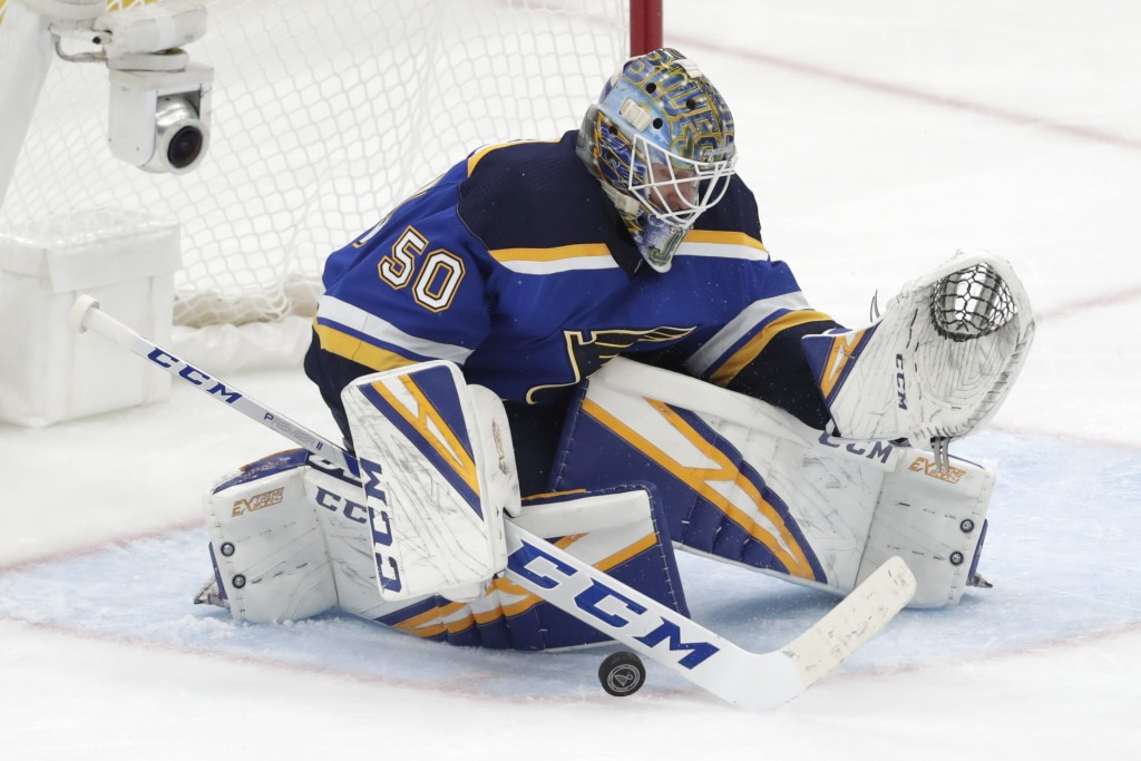 St. Louis Blues goaltender Jordan Binnington blocks a shot against the San Jose Sharks during the third period in Game 6 of the NHL hockey Stanley Cup