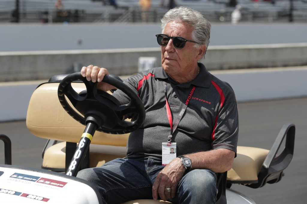FILE - In this Saturday, May 18, 2019 file photo, 1969 Indianapolis 500 champion Mario Andretti sits in his golf cart during qualifications for the In...