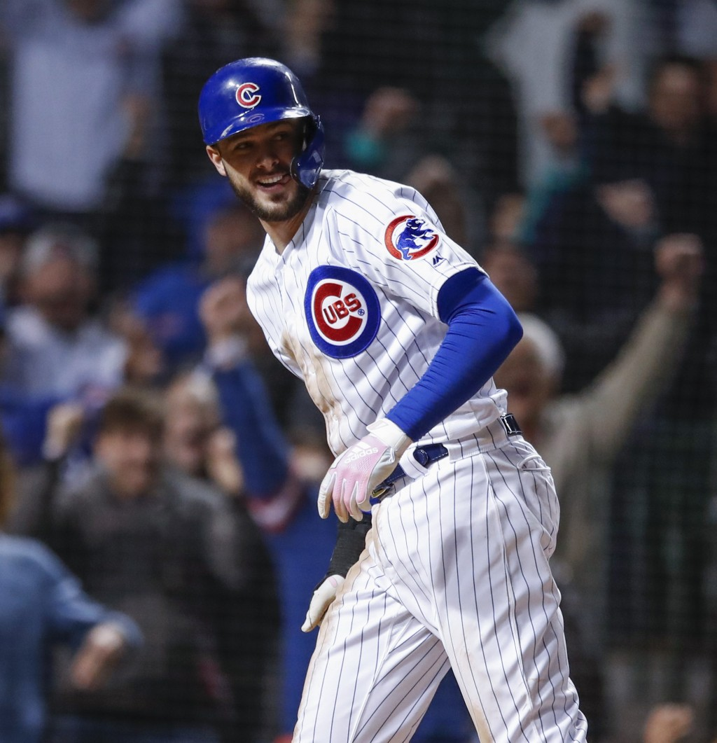 Chicago Cubs' Kris Bryant smiles after scoring against the Philadelphia Phillies during the ninth inning of a baseball game, Tuesday, May 21, 2019, in...