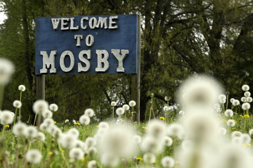 In this photo taken April 24, 2019, a sign welcomes visitors to the small community of Mosby, Mo. The residents of this small riverside town have beco...