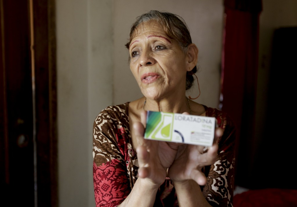 In this April 11, 2019 photo, Bertha Dun shows medicine bought with cryptocurrency through online transfers, in Barquisimeto, Venezuela, Thursday, Apr...