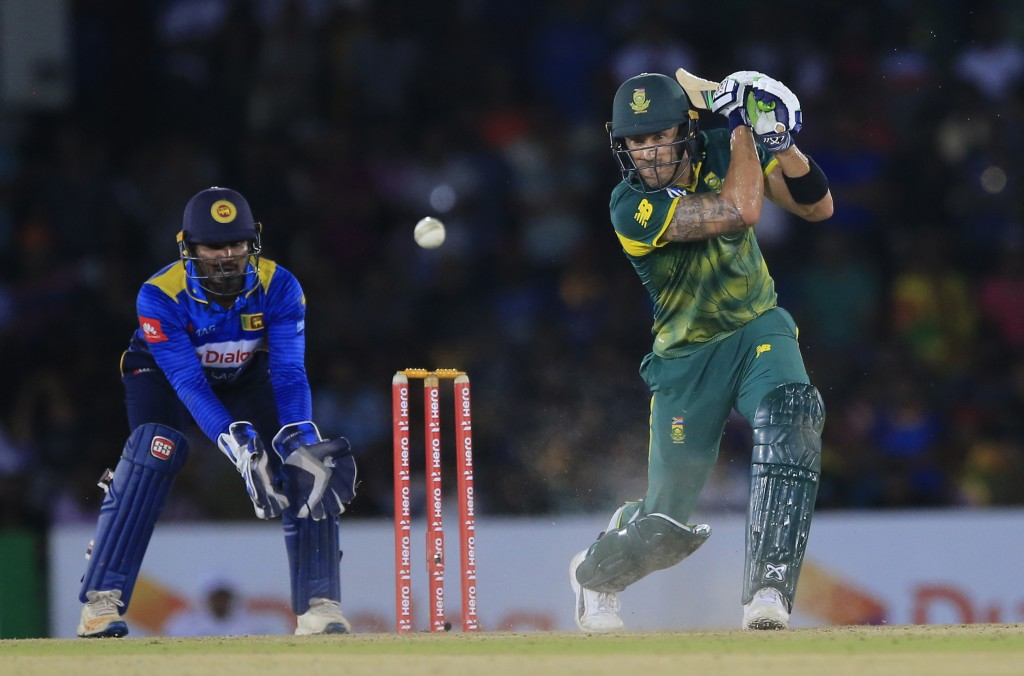 FILE - In this Wednesday, Aug. 1, 2018 file photo, South Africa's Faf du Plessis plays a shot as Sri Lankan wicket keeper Kusal Perera watches during ...