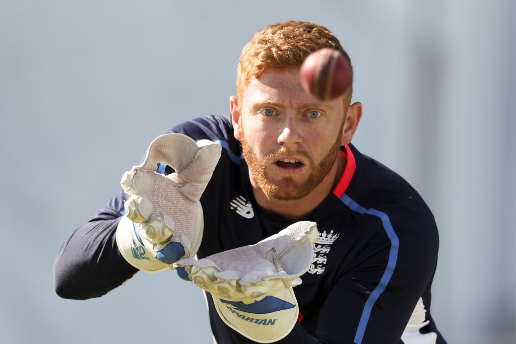 FILE - In this Saturday, Feb. 2, 2019 file photo, England's wicket keeper Jonny Bairstow warms up prior to the start of day three of the second Test c...