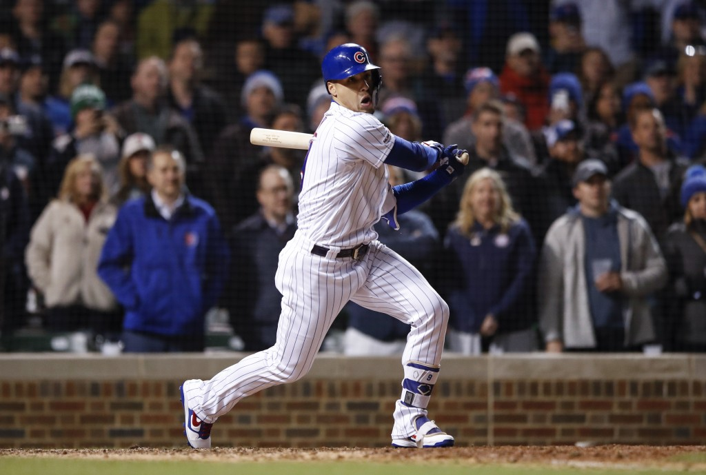Chicago Cubs' Javier Baez watches his game winning RBI-single against the Philadelphia Phillies during the ninth inning of a baseball game, Tuesday, M...