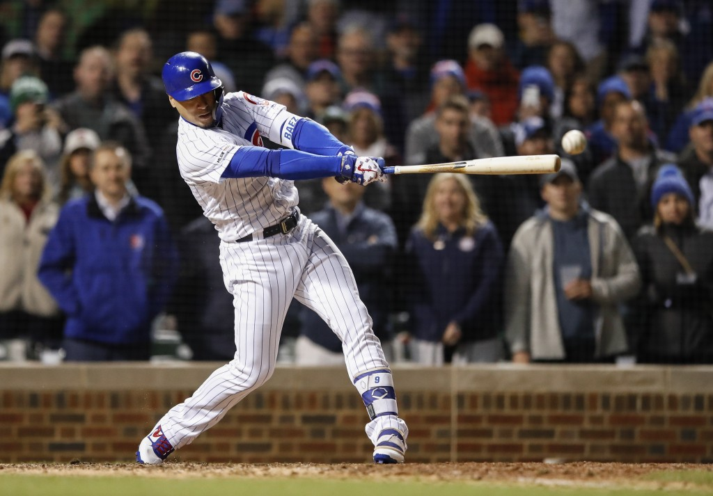 Chicago Cubs' Javier Baez hits a game winning RBI-single against the Philadelphia Phillies during the ninth inning of a baseball game, Tuesday, May 21