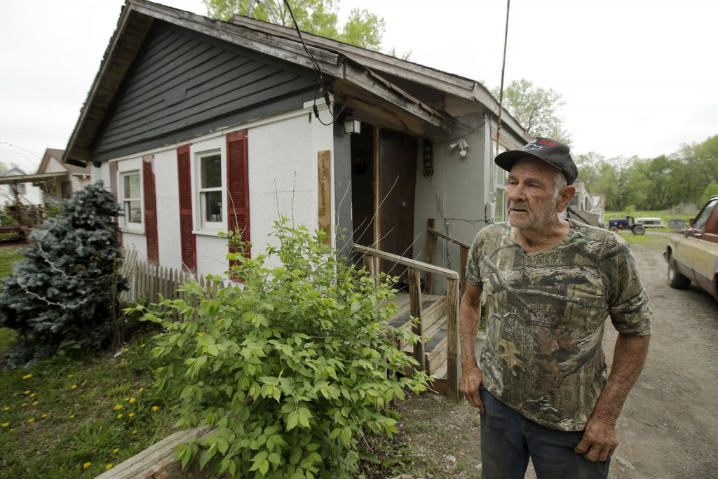 In this photo taken April 24, 2019, Elmer Sullivan talks about the times his house has flooded out in the small community of Mosby, Mo. Sullivan and n...