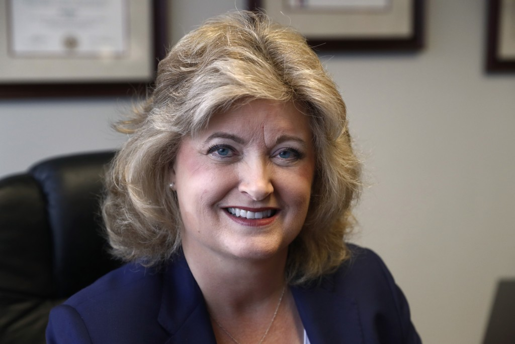 In this Tuesday, May 14, 2019, photo, business owner Meloney Perry, of Perry Law, poses for a portrait in her office at her law firm in Dallas. Perry