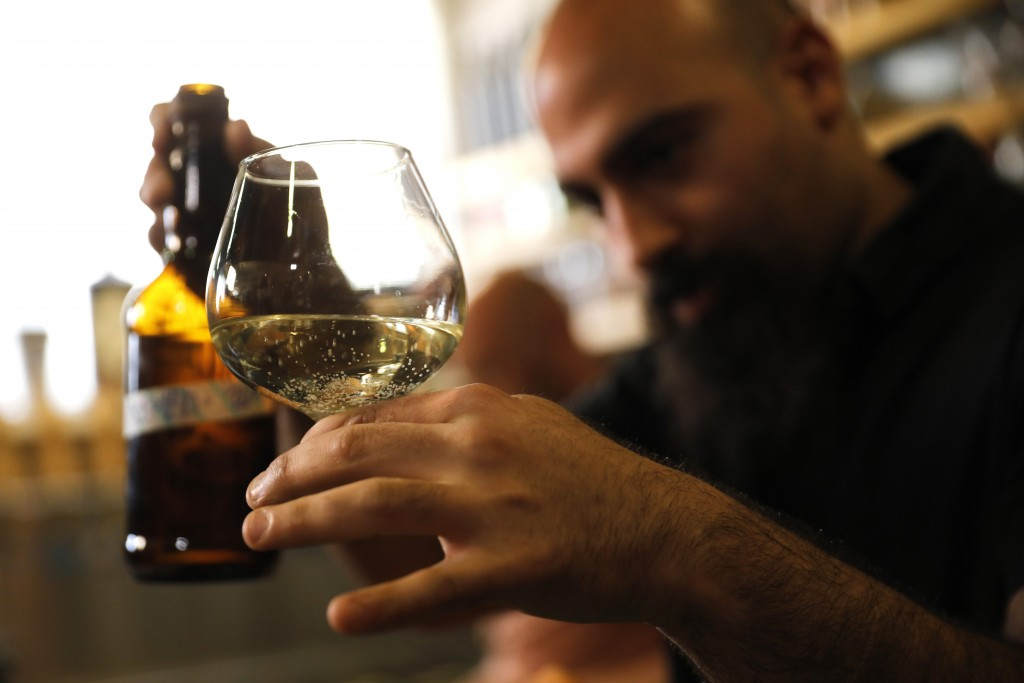 Craft brewer from Biratenu, the Jerusalem Beer Center, Shmuel Naky, right, pours beer during a press conference in Jerusalem, Wednesday, May 22, 2019....