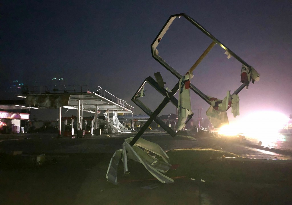 A destroyed sign for a car wash is seen in tornado-hit Jefferson City, MO., Thursday, May 23, 2019. The heavily damaged gas station is at background. ...
