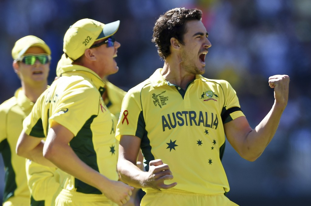FILE - In this March 29, 2015, file photo, Australia's Mitchell Starc, right, celebrates after taking the wicket of New Zealand captain Brendon McCull...