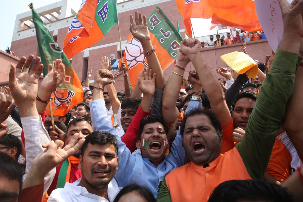 Bharatiya Janata Party (BJP) supporters celebrate their party's victory in the general elections in New Delhi, India, Thursday, May 23, 2019. Indian P...