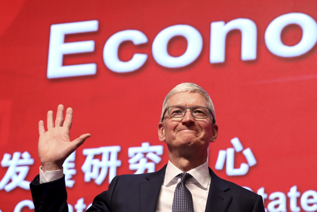 FILE - In this Saturday, March 23, 2019, file photo, Apple CEO Tim Cook waves as he arrives for the Economic Summit held for the China Development For...