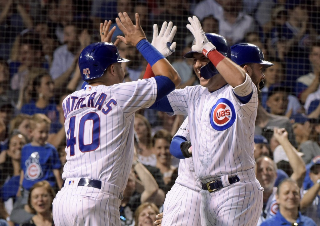 CORRECTS TO FIFTH INNING - Chicago Cubs' Willson Contreras (40) congratulates Albert Almora Jr. (5) on his on his grand slam against the Philadelphia