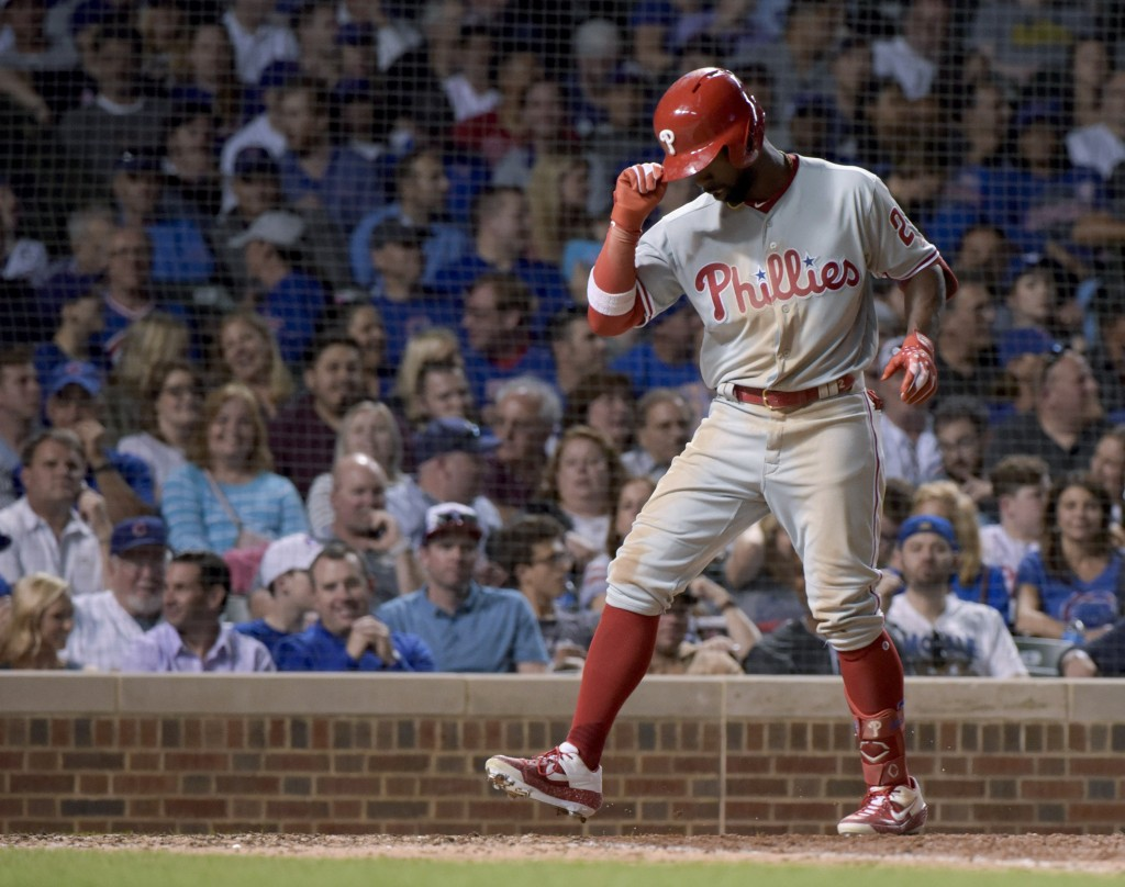 Philadelphia Phillies' Andrew McCutchen (22) scores on his home run against the Chicago Cubs during the eighth inning of a baseball game Wednesday, Ma