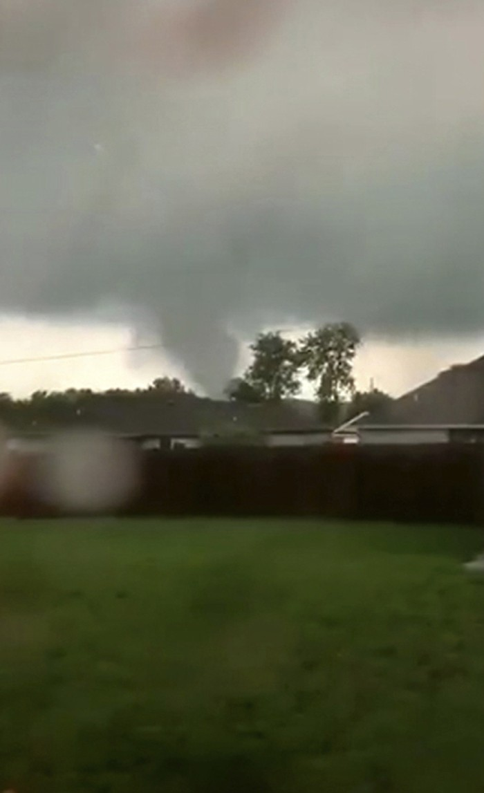 This still image taken from video provided by Shayla Brooks shows a tornado on Wednesday, May 22, 2019, in Carl Junction, Mo. The tornado caused some ...