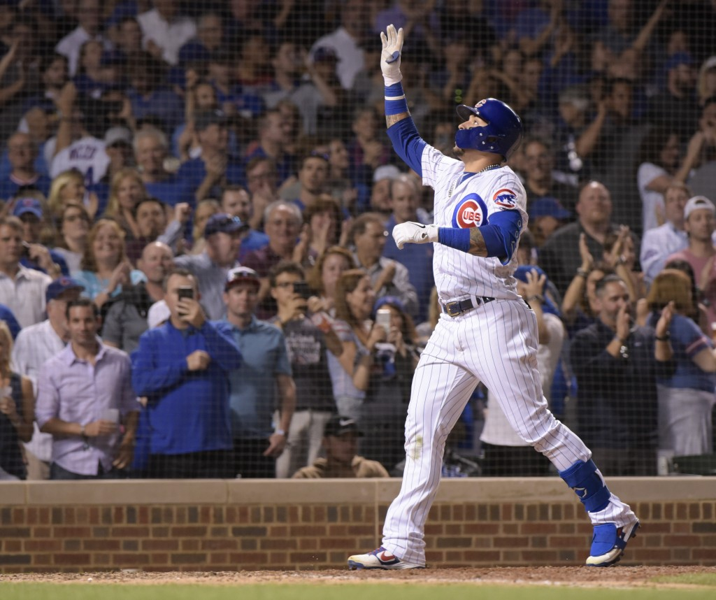 Chicago Cubs Javier Baez (9) celebrates his home run during the seventh inning against the Philadelphia Phillies in a baseball game Wednesday, May 22,