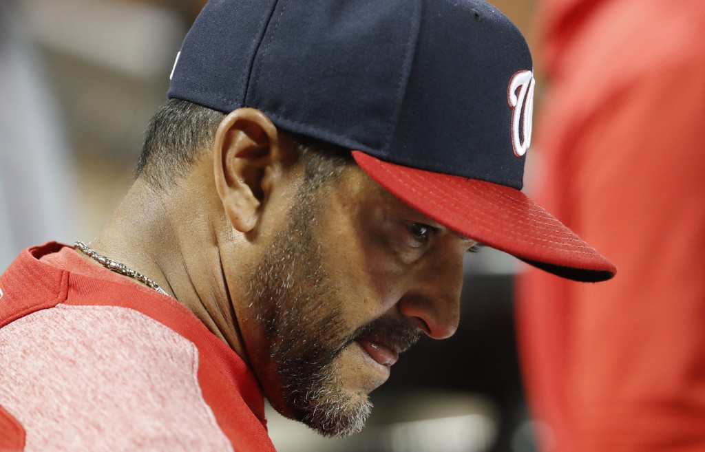 Washington Nationals manager Dave Martinez reacts in the dugout during the eighth inning of the team's 6-1 loss to the New York Mets in a baseball gam...