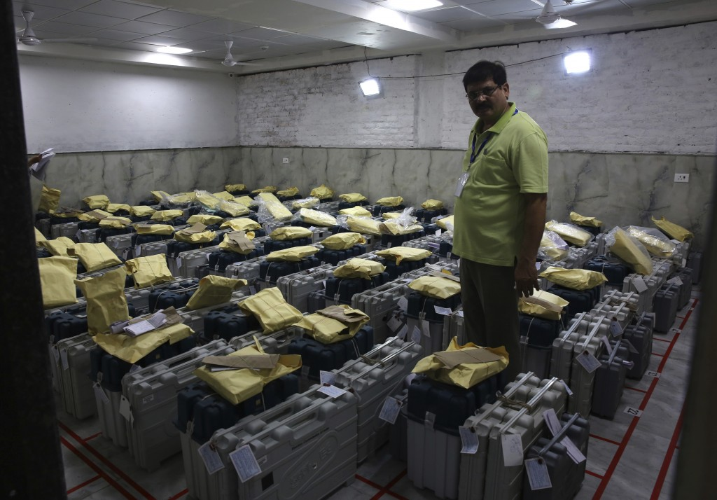 An election official checks electronic voting machines as counting votes of India's massive general elections begins in New Delhi, India, Thursday, Ma...