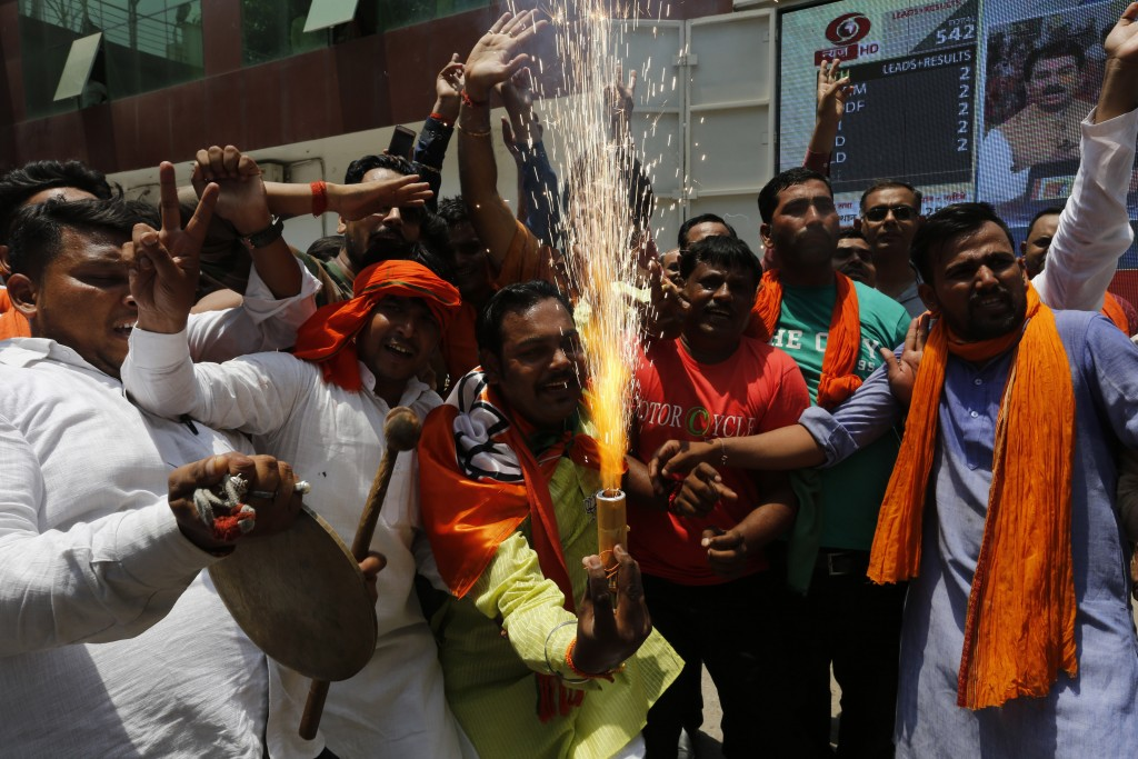 Bharatiya Janata Party (BJP) workers celebrate at BJP headquarters in, Lucknow, India, Thursday, May 23, 2019.  Indian Prime Minister Narendra Modi an...