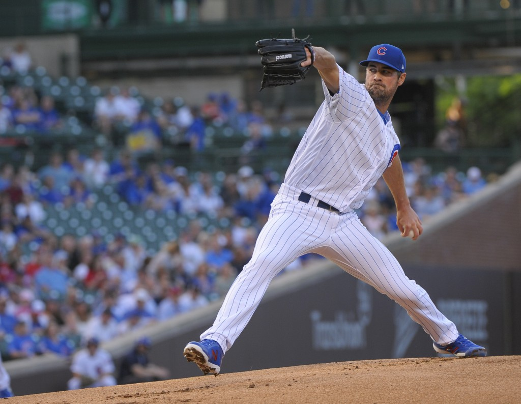 Chicago Cubs starting pitcher Cole Hamels throws t...