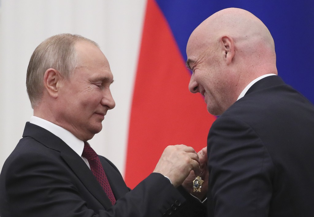 Russian President Vladimir Putin awards FIFA President Gianni Infantino during an awarding ceremony in the Kremlin in Moscow, Russia, Thursday, May 23