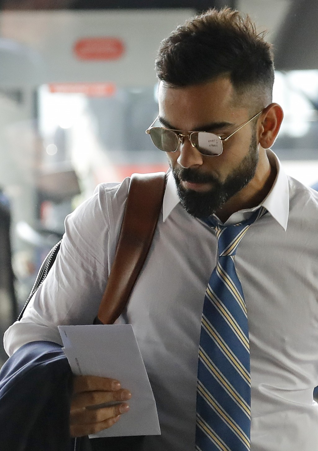 Indian cricket team captain Virat Kohli arrives at the hotel in London ahead of the start of the 2019 Cricket World Cup in London, Wednesday, May 22, ...