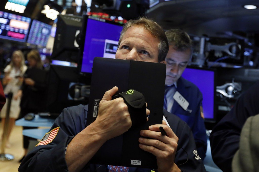 FILE - In this May 17, 2019, file photo trader Robert Charmak works on the floor of the New York Stock Exchange. The U.S. stock market opens at 9:30 a...