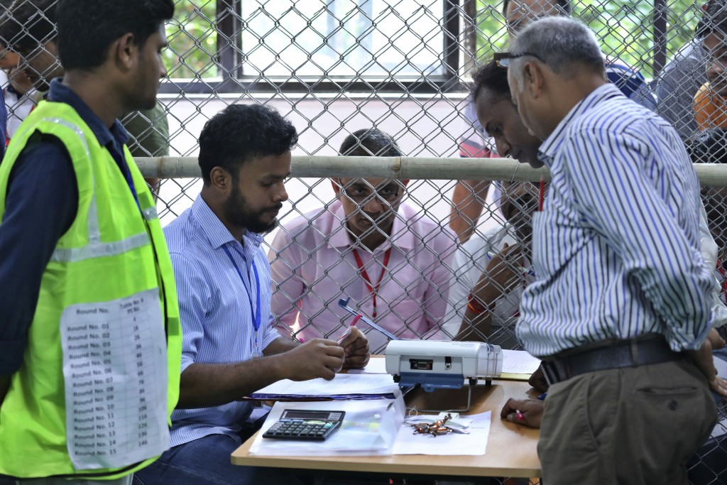 Election officials begin counting votes of India's massive general elections, in New Delhi, India, Thursday, May 23, 2019. The count is expected to co...