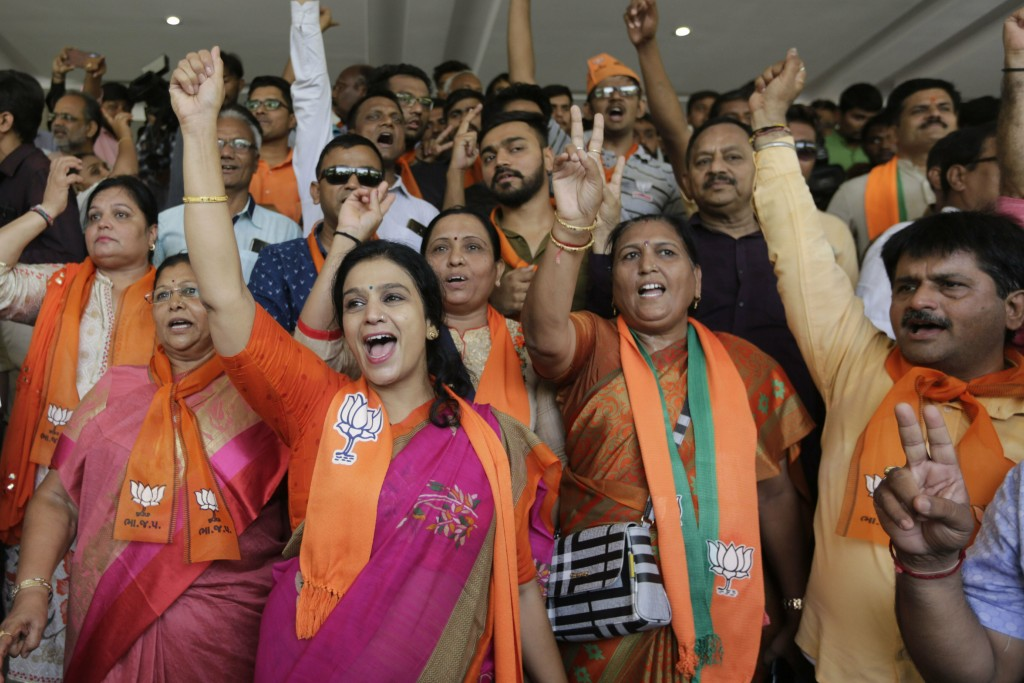 Supporters of India's ruling Bharatiya Janata Party celebrates early trends of party's victory in general elections at party's state head quarter in G...