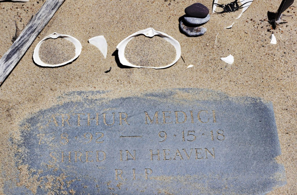 In the May 22, 2019, photo, a memorial stone for Arthur Medici, who died of injuries sustained in a shark attack while boogie boarding the previous su
