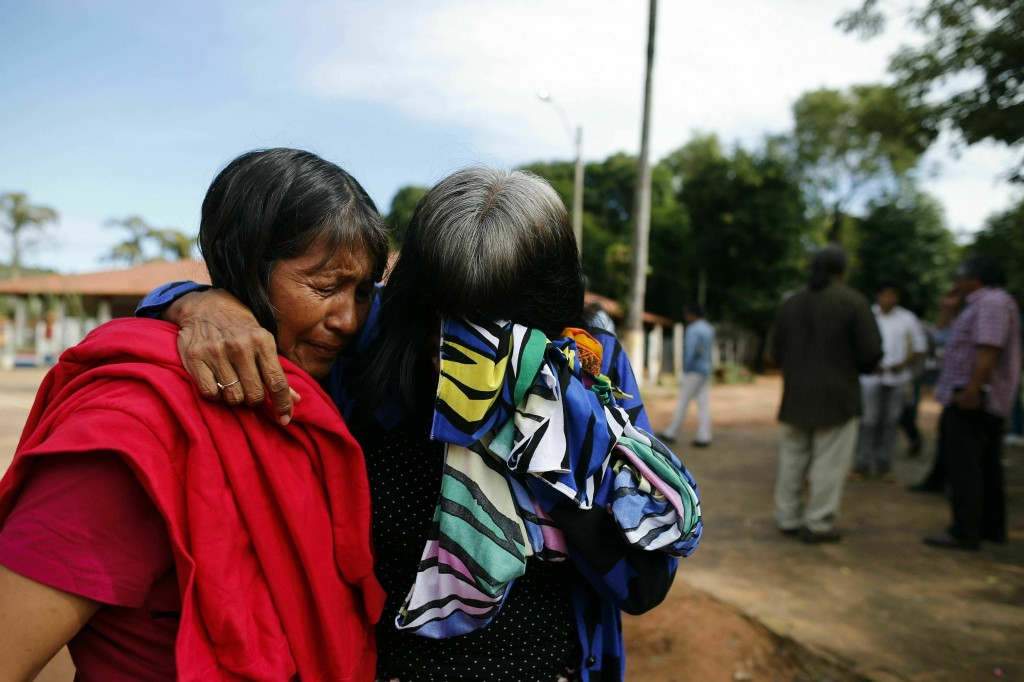 Maka indigenous leader-in-training Tsiweyenki, or Gloria Elizeche in Spanish, right, is comforted by her friend Isabel as she mourns her late husband,