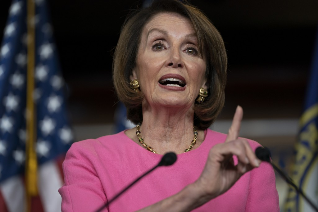 FILE - In this May 23, 2019 file photo, Speaker of the House Nancy Pelosi, D-Calif., meets with reporters at the Capitol in Washington.  An altered vi