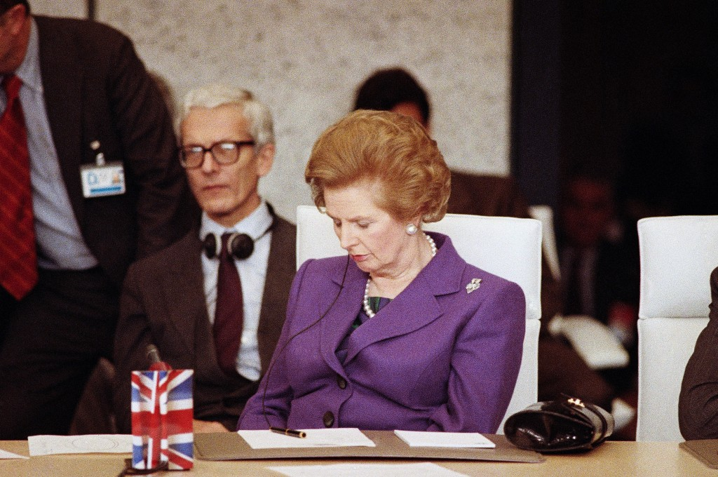 FILE - In this Thursday, Nov. 20, 1990 file photo, British Prime Minister Margaret Thatcher dozes off for a few minutes while attending the Conference