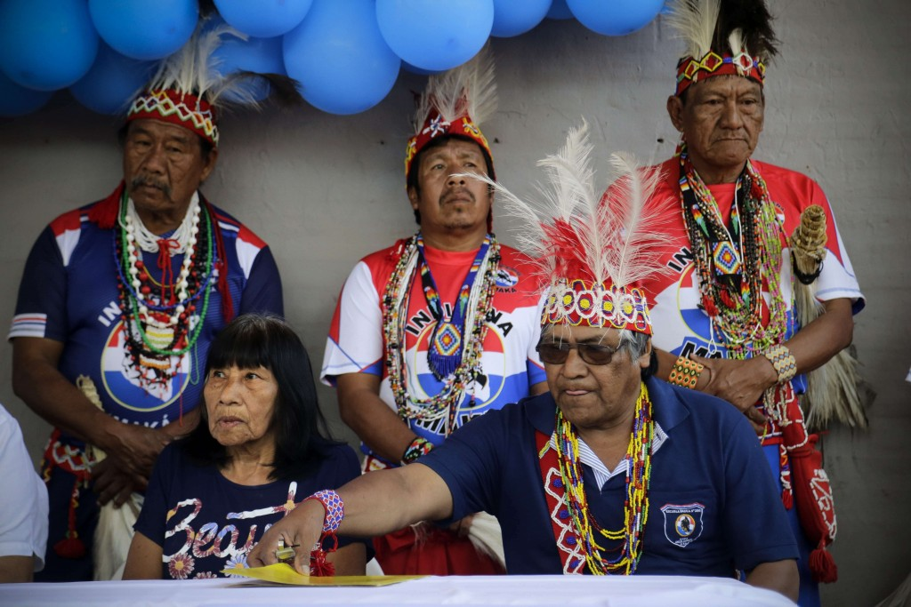 Maka indigenous leader-in-training Tsiweyenki, or Gloria Elizeche in Spanish, front left, attends a ceremony with Mateo Martinez, right, at which the